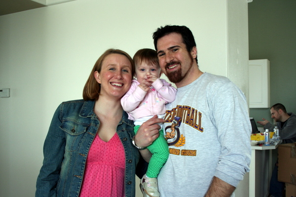 Lily, the littlest member of the moving crew, with mom Alyson and dad Jim.